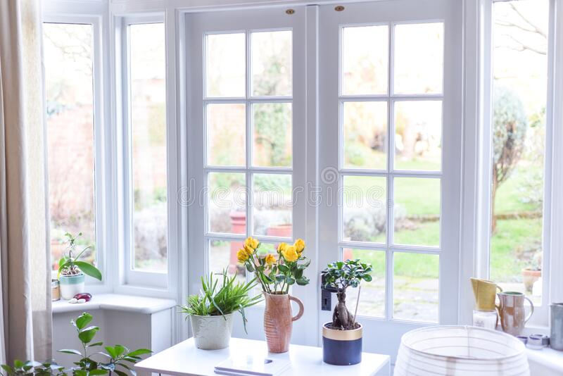 Stylish room interior with french doors and light neutral colours in a modern home. Light and airy room stock images