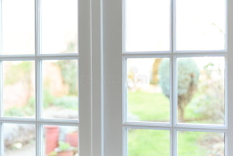 Stylish room interior with french doors and light neutral colours in a modern home. Close up on windows royalty free stock photos