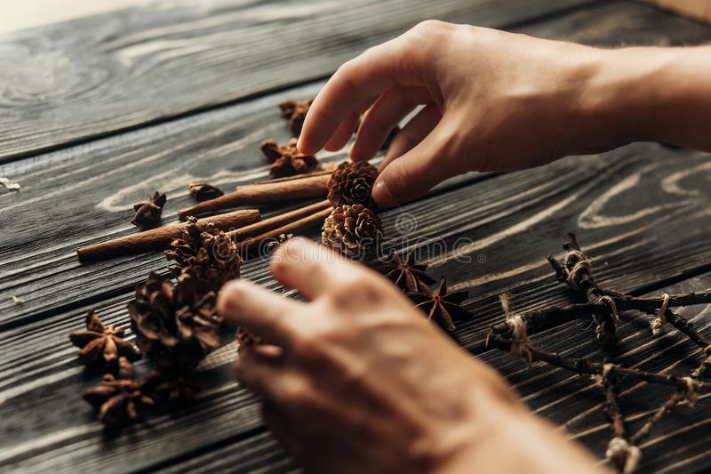 Stylish rustic winter picture with hands arranging anise and pin stock photos
