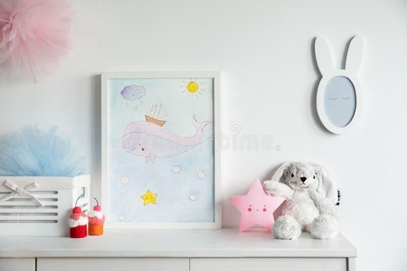 Stylish scandinavian newborn baby shelf with mock up photo frame, box, teddy bear and toys royalty free stock photography