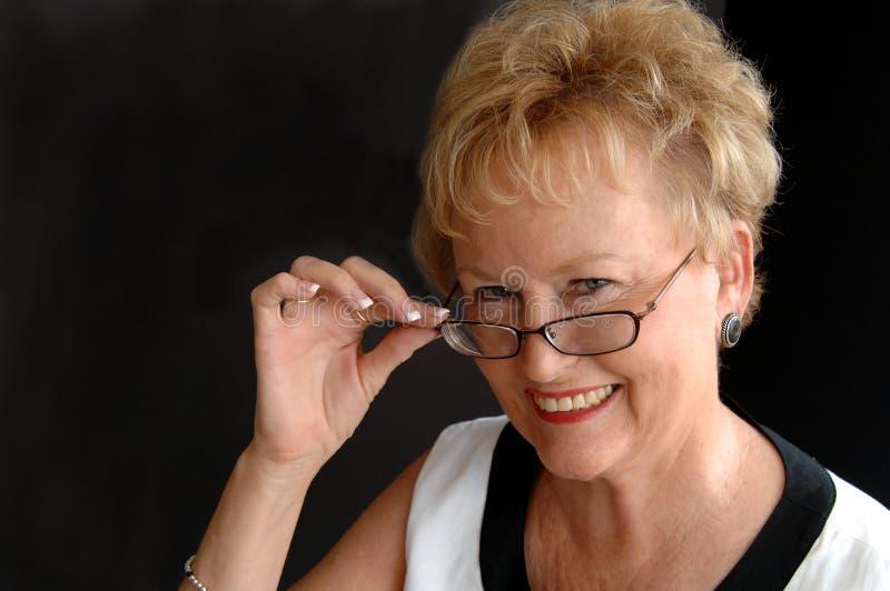 Stylish senior wearing glasses stock photos