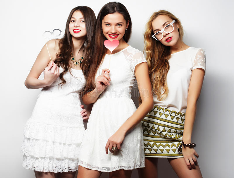 Stylish girls best friends ready for party. royalty free stock photography