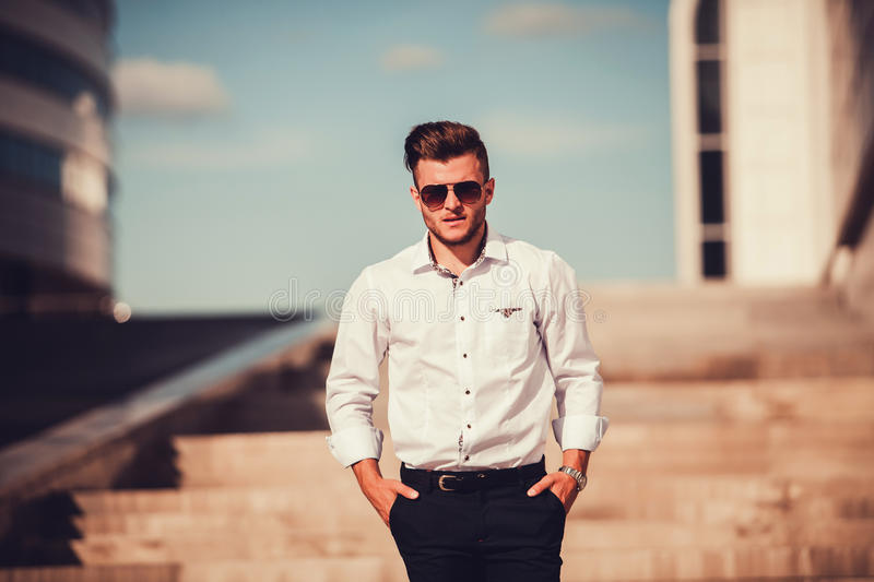 Stylish handsome model man. In casual clothes lifestyle in the street in glasses royalty free stock image