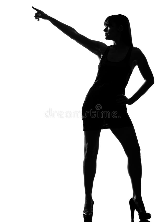 Stylish silhouette woman dancer dancing pose. Stylish silhouette caucasian beautiful woman dancer dancing pose posture on studio isolated white background royalty free stock photos