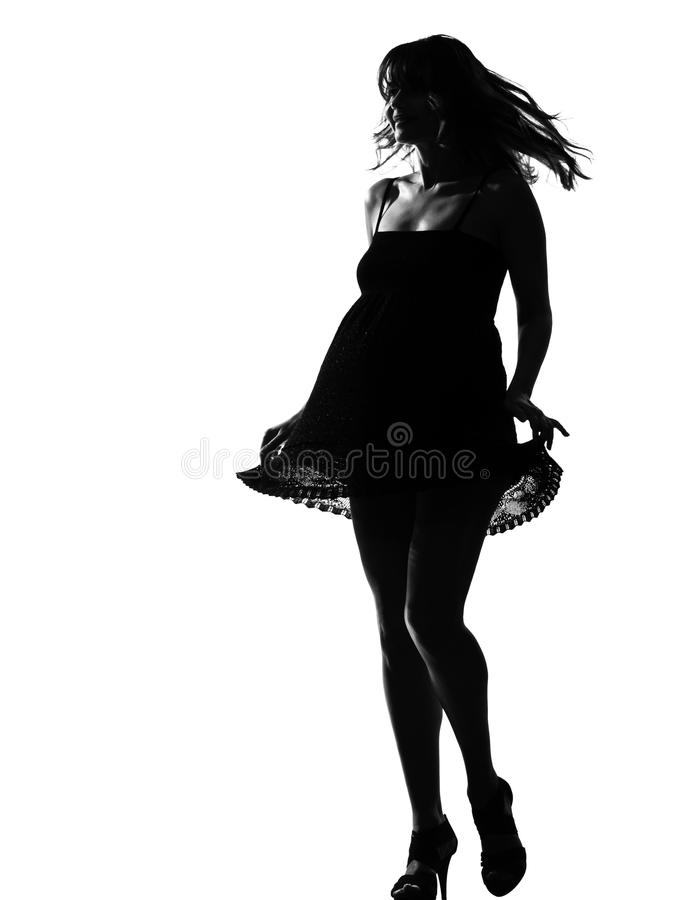 Stylish silhouette woman walking dancing. Stylish silhouette caucasian beautiful woman walking dancing sumer dress full length on studio isolated white royalty free stock photos