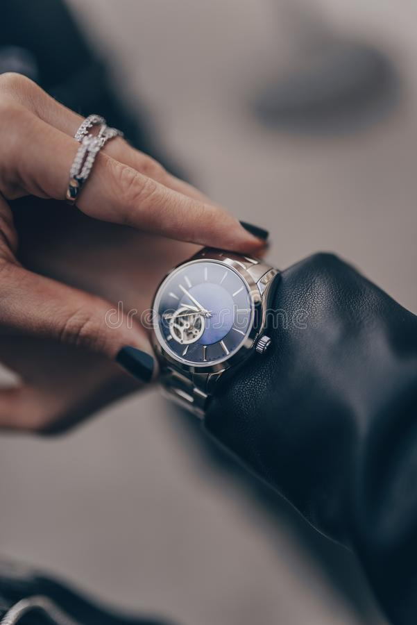 Stylish silver watch on woman hand royalty free stock photography