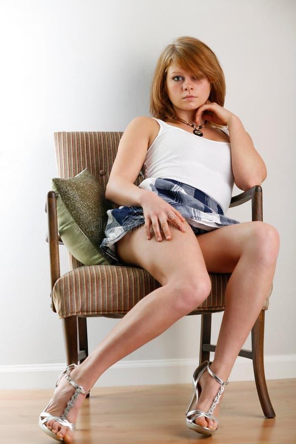 Stylish sitting woman stock image