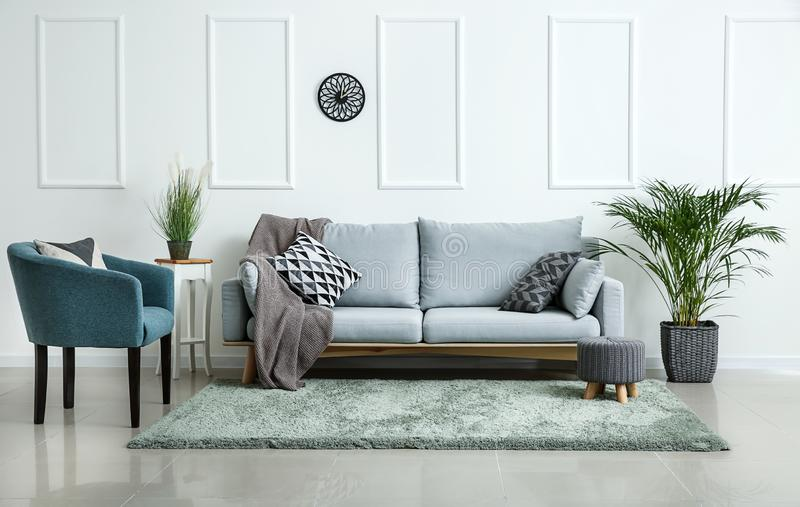 Stylish soft furniture in interior of living room stock photography