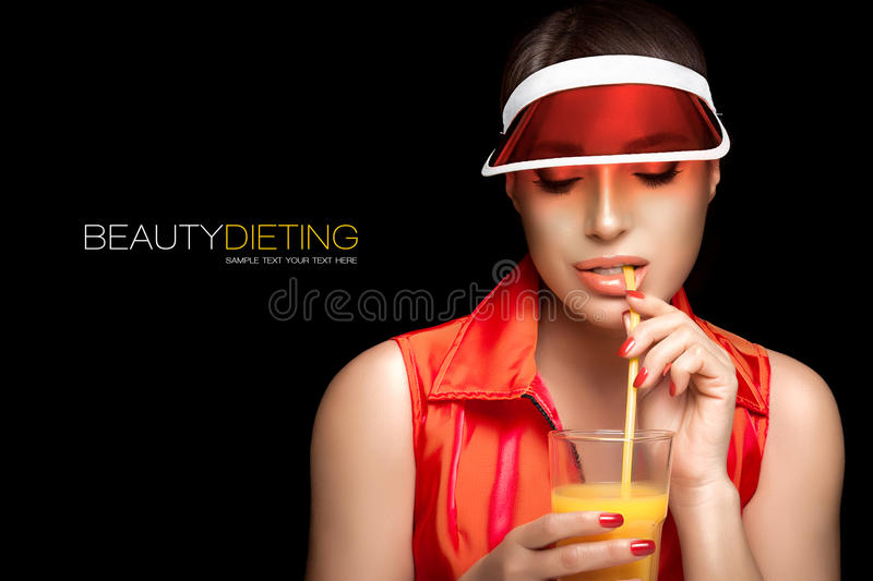 Stylish Sporty Woman Sipping a Glass of Juice. Beauty Dieting royalty free stock photo
