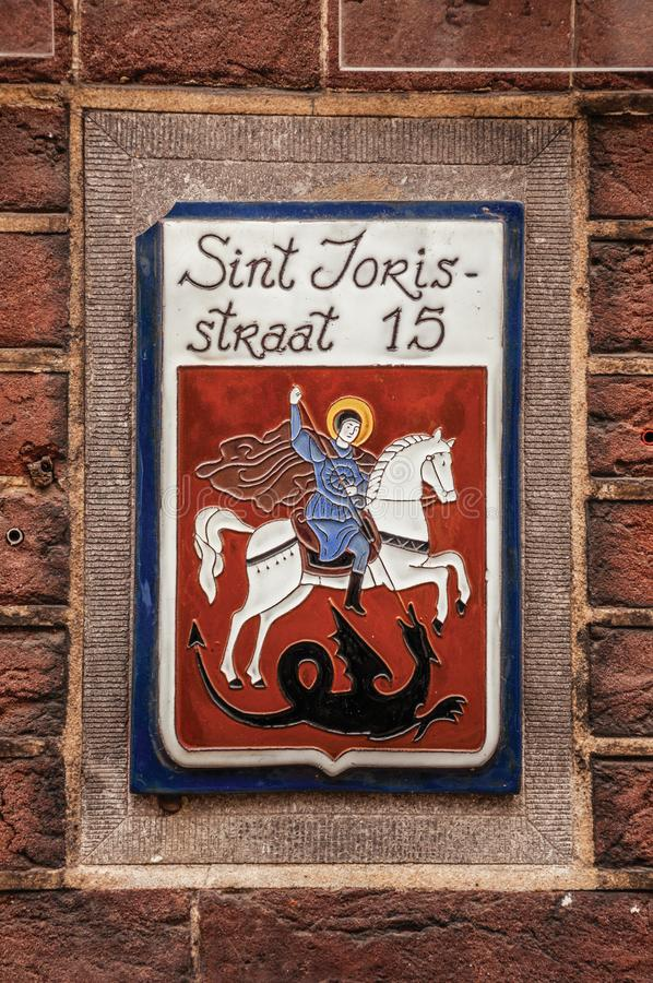 Free Stylish Street Sign With Enameled Paint Of Saint George And Dragon, In Street With The Name Of The Saint In S-Hertogenbosch. Stock Photography - 106930602