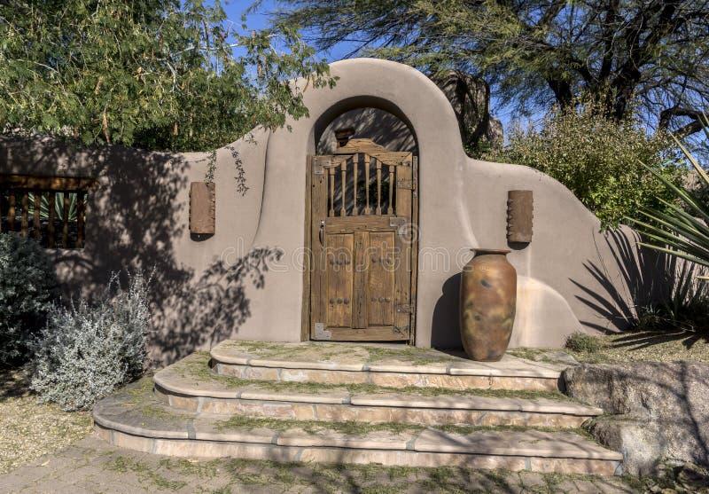 Stylish stucco rustic wood door archway royalty free stock photo