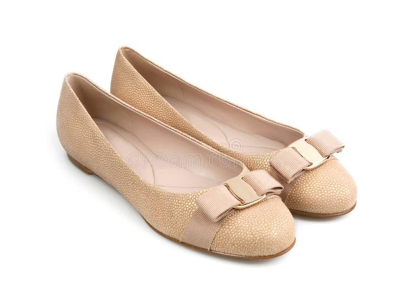 Stylish summer female beige fabric shoes stock images
