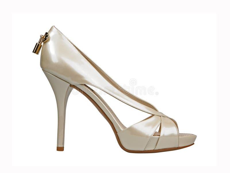 Stylish summer high heels female white leather shoe. Isolated on white background stock photo