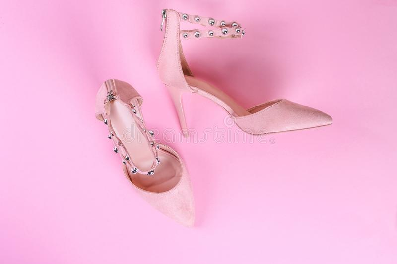 Stylish summer sandals of pastel color isolated on pink background, close up. Top view. Flat lay stock photography