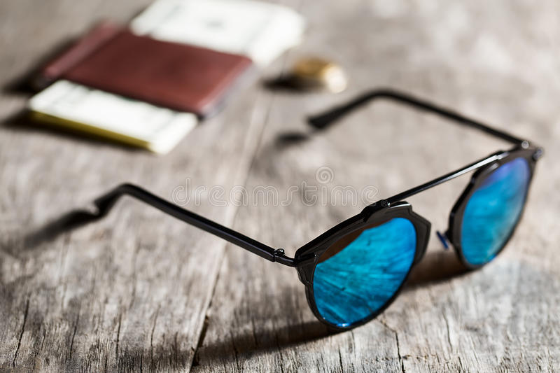 Stylish sunglasses with blue tinted mirror on stock photos
