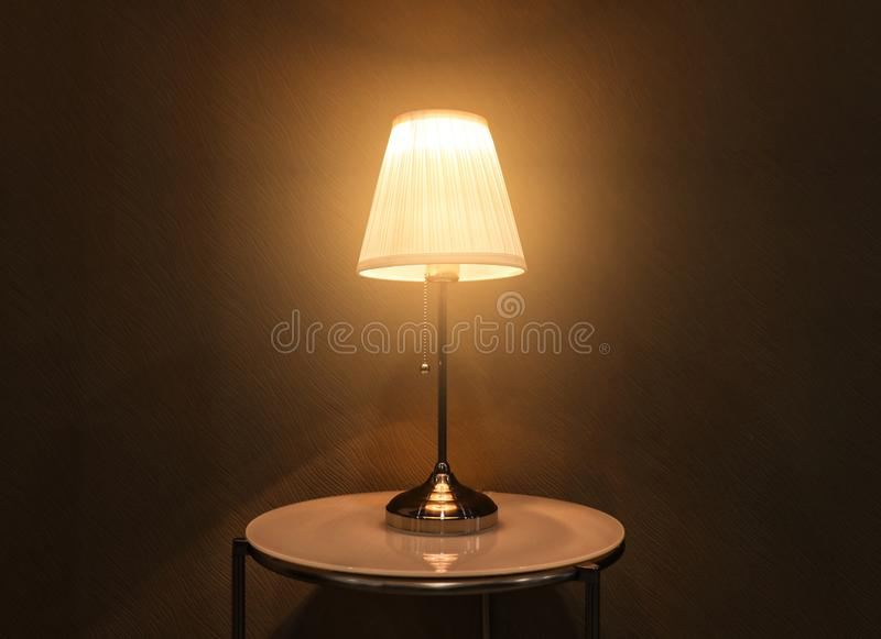Stylish table lamp. In dark room stock photo