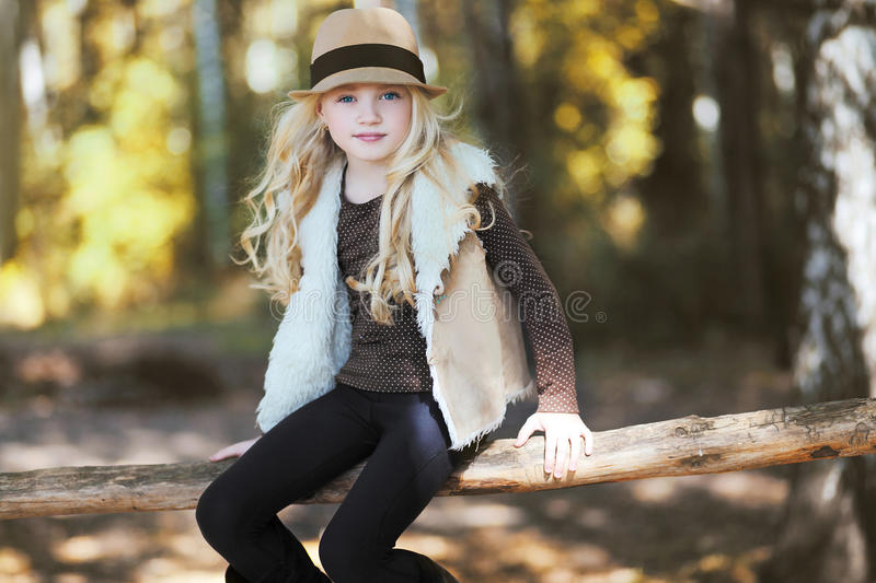 Stylish teen girl, blonde. Country, rustic, ranch - style stock image