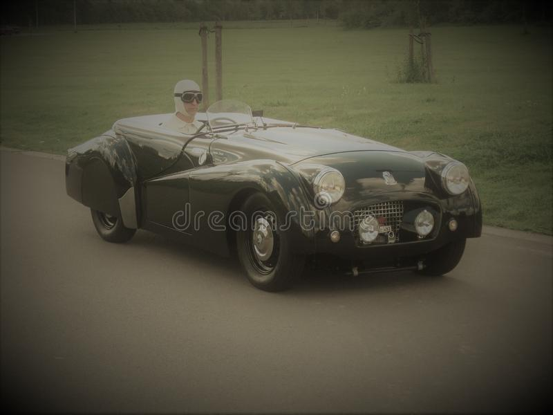 Stylish Triumph TR2 oldtimer. A stylish oldtimer Triumph TR2 visiting the town of Jabbeke Belgium during a Triumph meeting royalty free stock photography