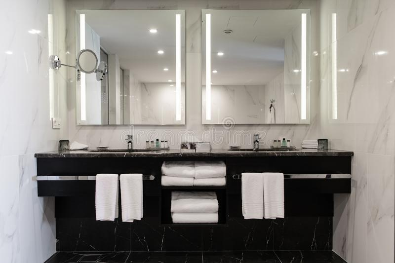 Stylish twin bathroom with two sinks and mirror. Stylish twin bathroom with two sinks and mirror royalty free stock photos