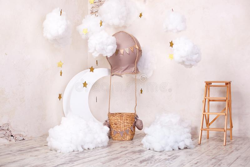 Stylish vintage children`s room with aerostat, balloon and textile clouds. Children`s location for a photo shoot: aerostat, balloo. N and clouds. Place for a royalty free stock photography