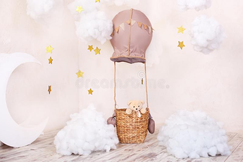 Stylish vintage kids room with aerostat, moon and clouds. Little traveler. Room for children to play. The concept of childhood, im. Agination. Kindergarten stock images