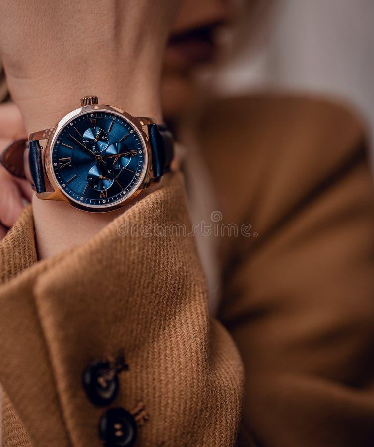 Stylish beautiful blue watch on woman hand royalty free stock image