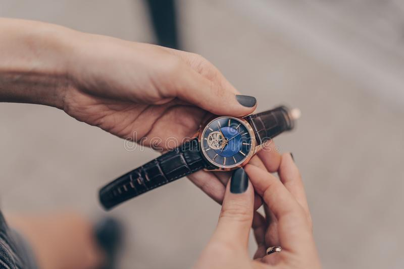 Stylish elegant watch in woman hands royalty free stock photo