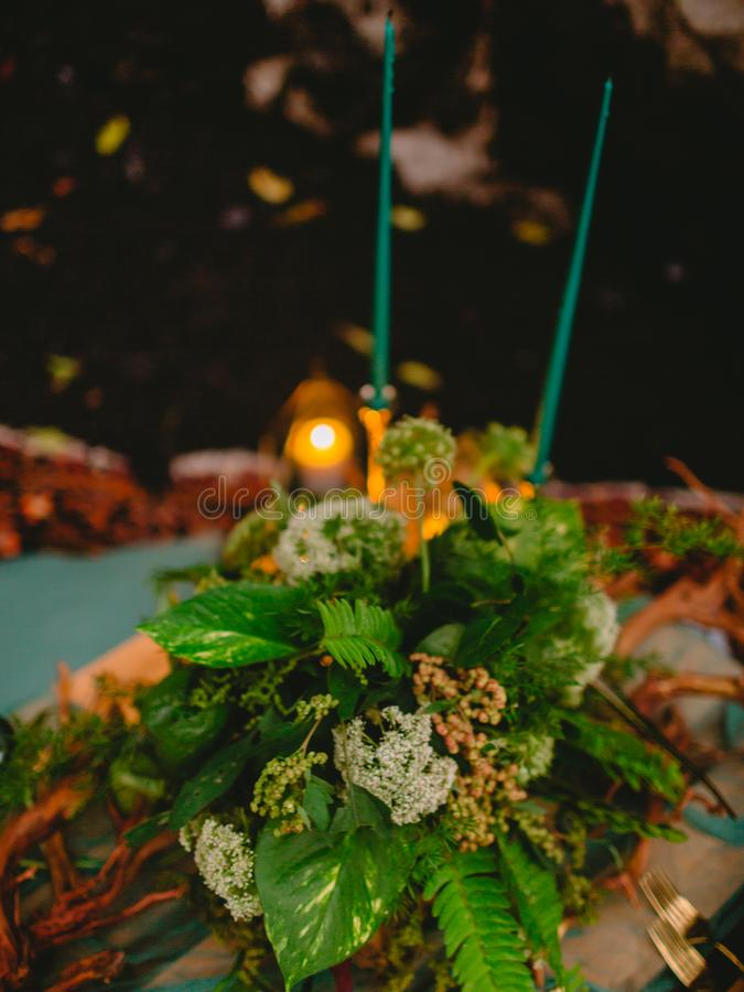 Stylish wedding decoration with candles, decor and floristic. Wedding. Dinner royalty free stock photos