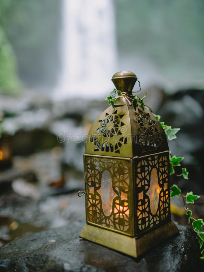 Stylish wedding decoration with candles. In outdoor stock image