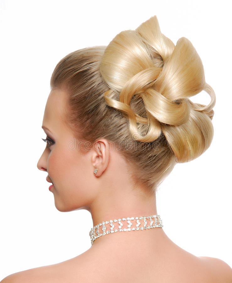 Stylish wedding hairstyle. Modern wedding hairstyle rear view isolated on white royalty free stock photography