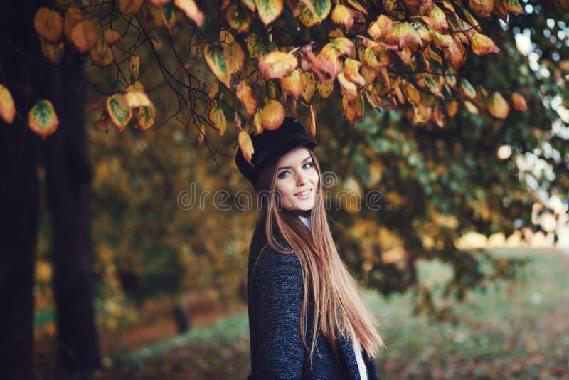 Stylish woman in autumn park. Fashion portrait of stylish woman in autumn park stock photography