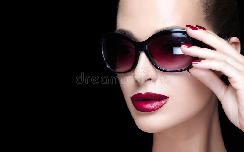Stylish woman with bright makeup and trendy glasses royalty free stock images