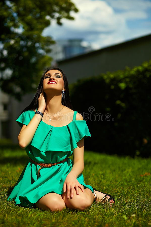 Stylish woman girl on casual green dress stock photos