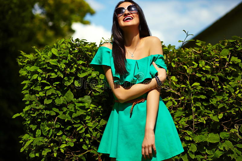 Stylish woman girl on casual green dress stock image