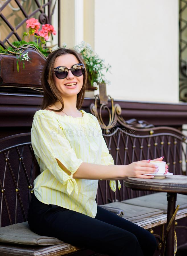 Stylish woman in glasses drink coffee. girl relax in cafe. Business lunch. summer fashion beauty. Meeting in cafe. good stock images
