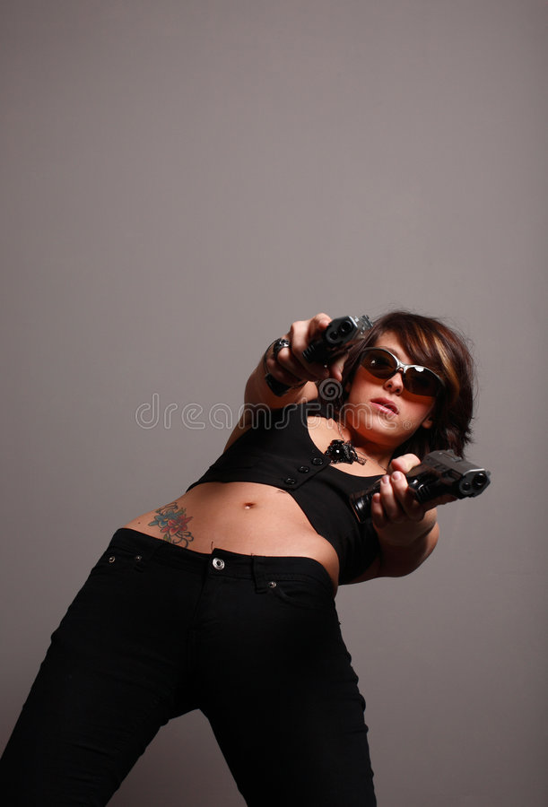 Stylish woman with guns royalty free stock images