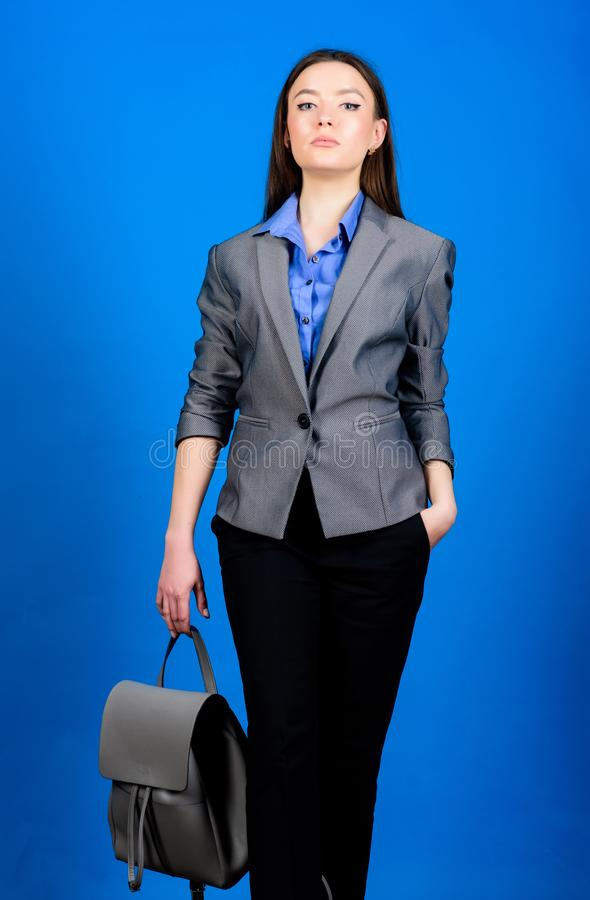 Stylish woman in jacket with leather backpack. Formal style accessories. Backpack for daily modern urban life. Girl. Student in formal clothes. Backpack fashion stock image
