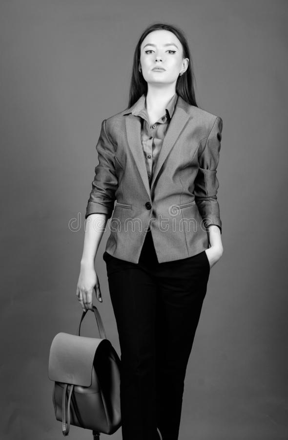 Stylish woman in jacket with leather backpack. Formal style accessories. Backpack for daily modern urban life. Girl. Student in formal clothes. Backpack fashion royalty free stock photos