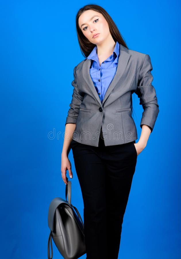Stylish woman in jacket with leather backpack. girl student in formal clothes. student life. Smart beauty. Nerd stock photo