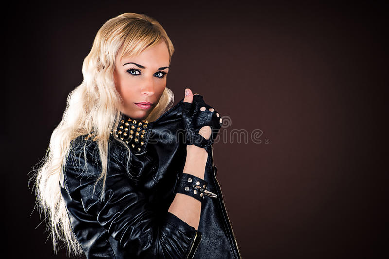 Stylish woman in a leather jacket royalty free stock image