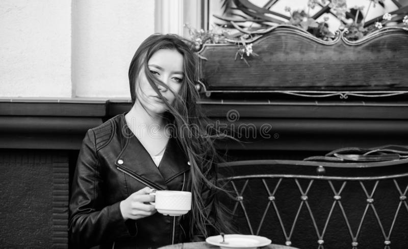 Stylish woman in leather jacket drink coffee. morning coffee. Waiting for date. good morning. Breakfast time. girl relax. In cafe. Business lunch. summer royalty free stock photography