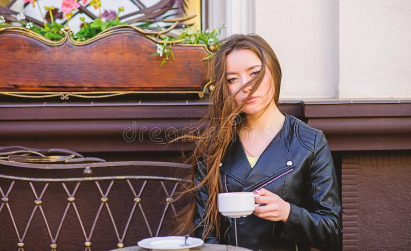 Stylish woman in leather jacket drink coffee. morning coffee. Waiting for date. good morning. Breakfast time. girl relax. In cafe. Business lunch. summer royalty free stock photos