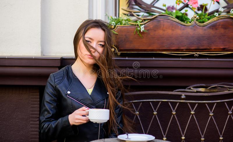 Stylish woman in leather jacket drink coffee. morning coffee. Waiting for date. good morning. Breakfast time. girl relax. In cafe. Business lunch. summer stock photo