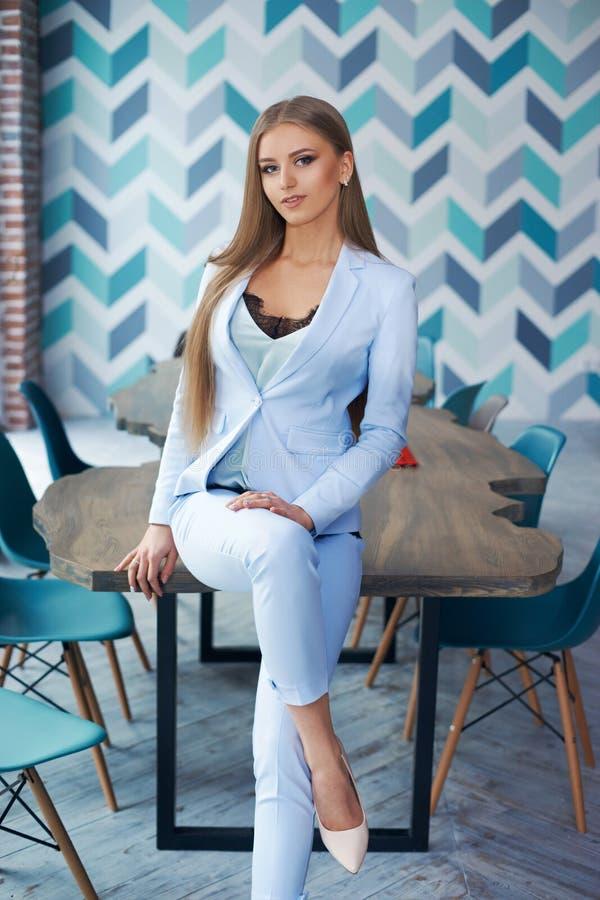 Stylish woman in modern interior stock image