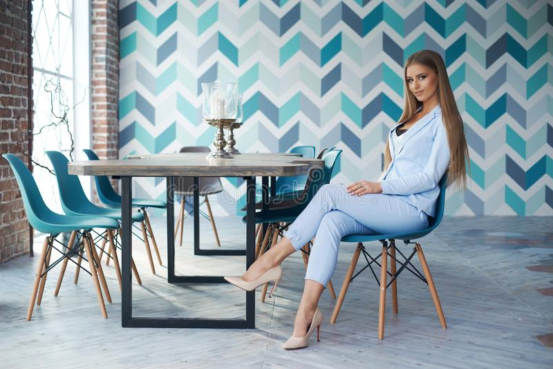 Stylish woman in modern interior stock images