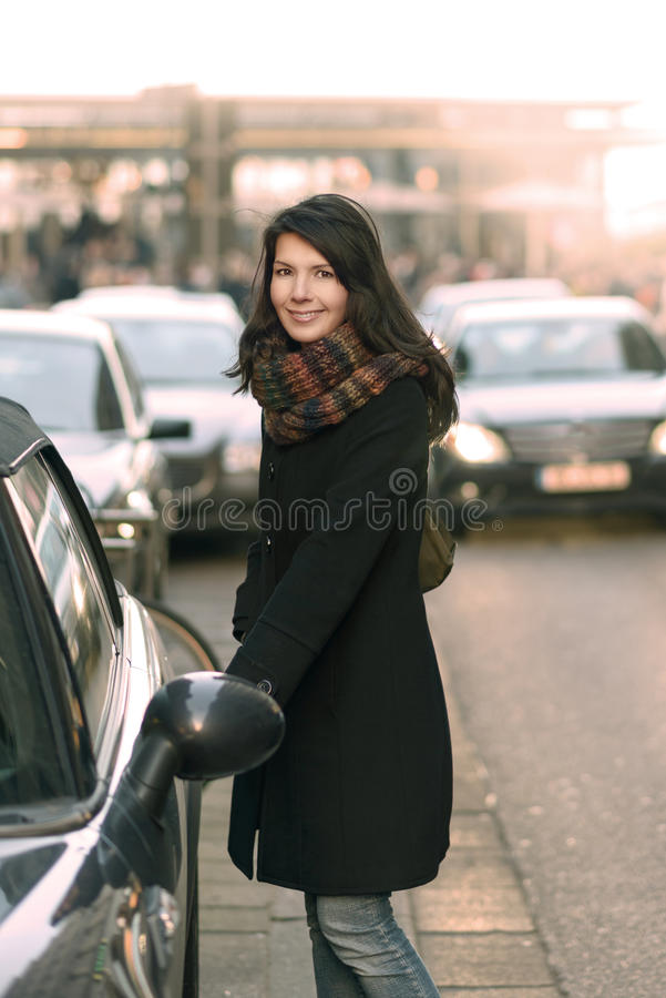Stylish Woman Opening her Car at the Street Side royalty free stock images