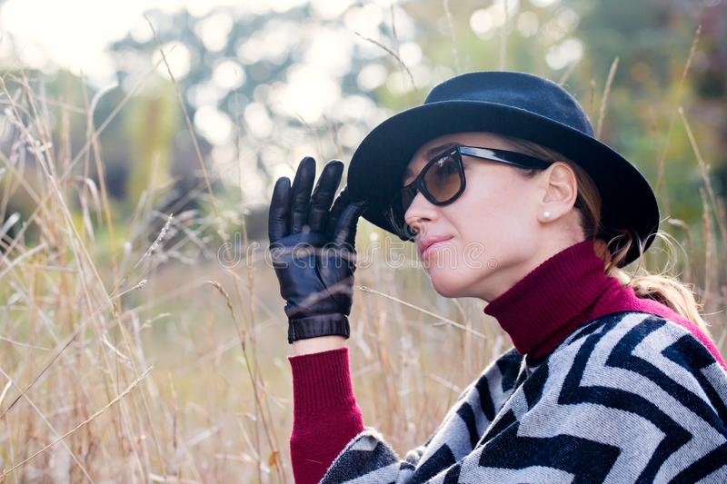 Woman in gloves and sunglasses royalty free stock photos