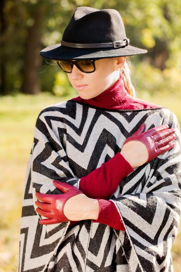 Woman in short gloves stock image