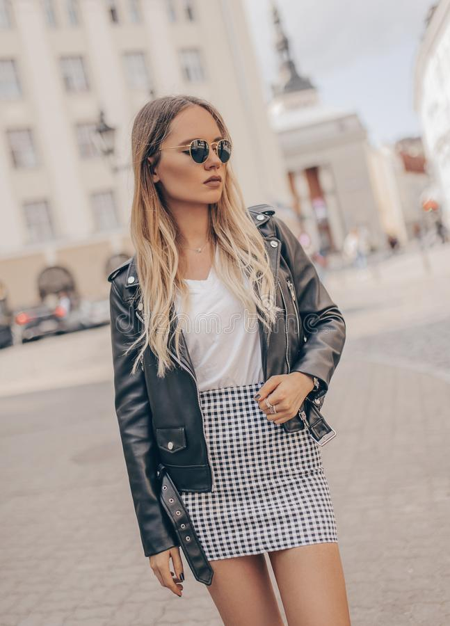 Stylish girl posing in the street. Fashion summer photo royalty free stock image