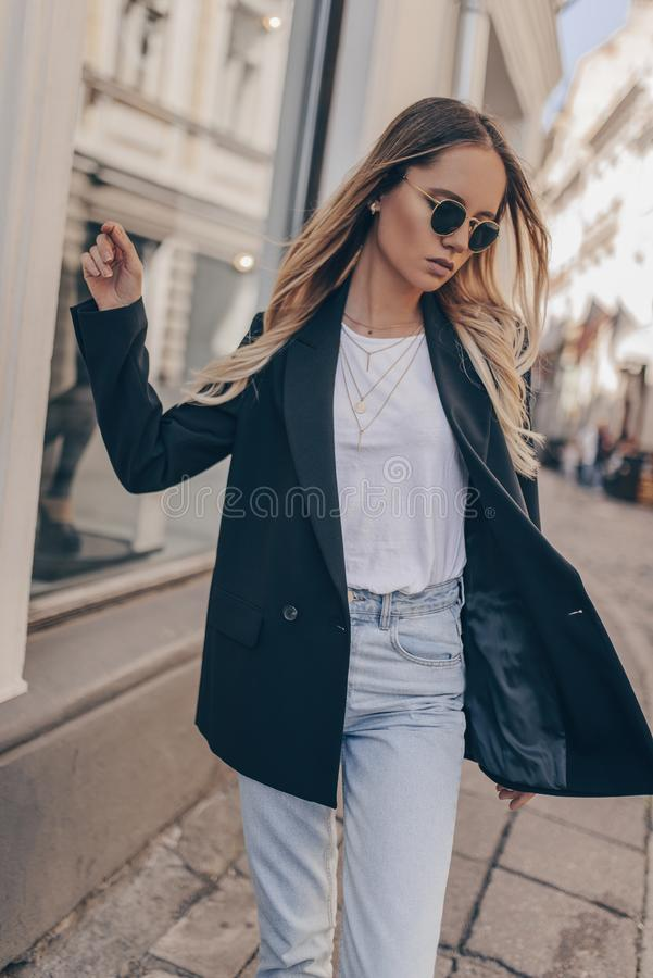 Stylish fashion girl posing in the street stock photos